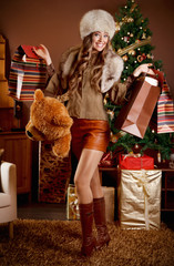 Pretty woman with many Christmas presents