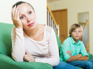 middle-aged woman and teenager son having conflict