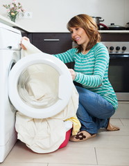 Ordinary girl using washing machine