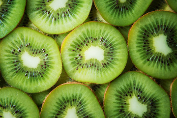 Fresh kiwi slices background