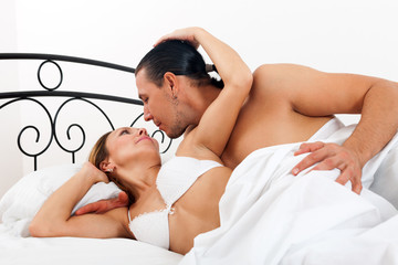 couple in bed in bedroom