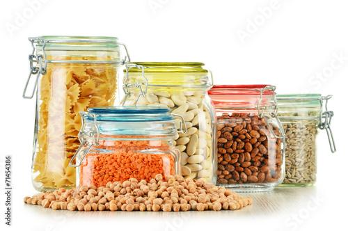 Fotobehang Granen Jars with grain foods isolated on white