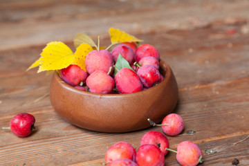 Crab apples in a wooden bowl