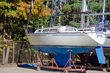 sailboat on cradle with autumn tree