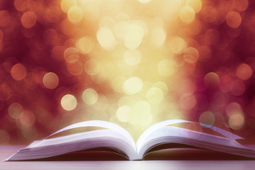 Open book against defocused lights