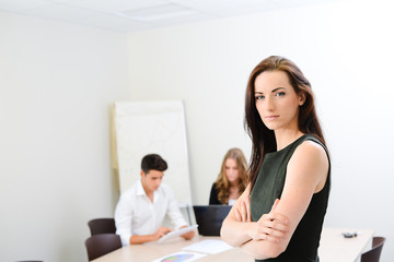 young woman executive manager in meeting room with staff