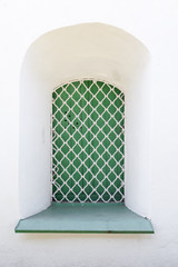 White wall and green window with grid, background texture