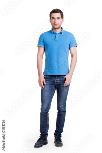 canvas print picture Full portrait of smiling happy handsome man in blue t-shirt.