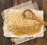 Unpolished rice with a spoon poster