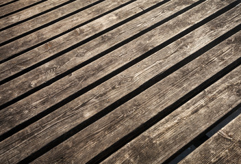 Uncolored weathered brown wooden lining boards background textur
