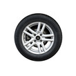 Photo of usual automotive wheel on light alloy disc isolated on