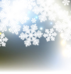 White defocused snowflakes on glow background. Christmas abstrac