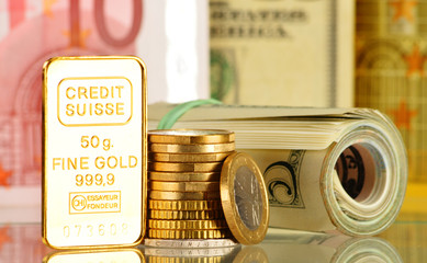 Composition with 50 gram gold bar, banknotes and coins