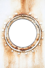 Empty round rusted porthole on white ship wall