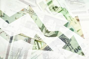 Saudi Arabia money background with negative trends arrows