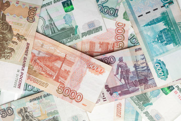 Russian money detailed background. Rubles banknotes closeup text