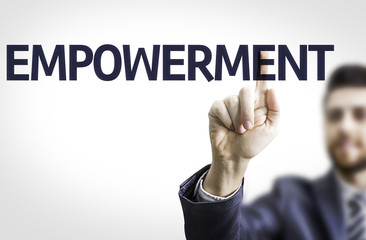 Business man pointing the text: Empowerment