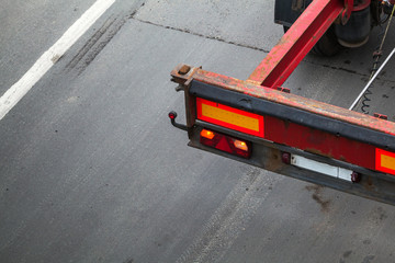 Back part with taillight of empty truck cargo trailer on the asp
