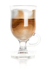 Mug made of glass with latte coffee, closeup studio photo
