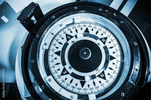 Naval compass. Blue toned monochrome close-up photo