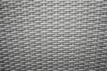 Gray wicker furniture surface. Background photo texture