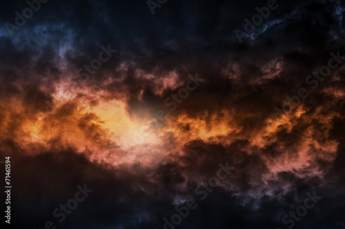 Leinwanddruck Bild Dark colorful stormy cloudy sky background photo