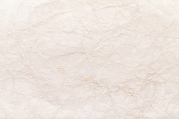 Old yellow crumpled paper sheet background texture