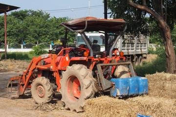 Orange tractor in a farm