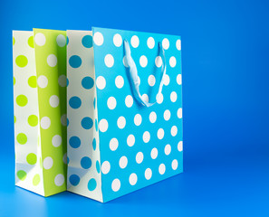 Blue and green polka dot gift bag