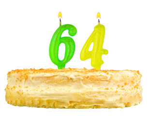 birthday cake with candles number sixty four isolated on white