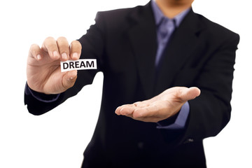 Man Holding Paper With Dream Text
