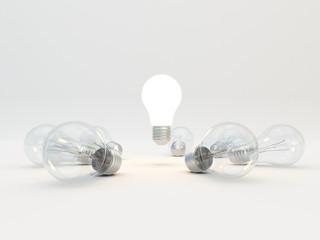 Idea concept with light bulbs on a gray background