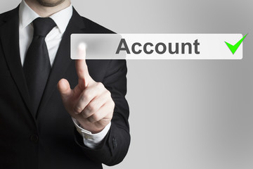 businessman pushing button account
