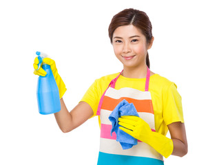 Asian housewife with spray and towel