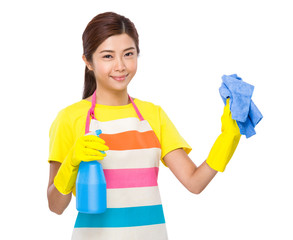 Asian housewife with detergent spray and towel