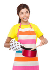 Asian housewife use of saucepan cooking