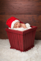 Newborn Baby Wearing a Santa Hat