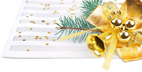 Christmas decorations and music sheet isolated on white backgrou