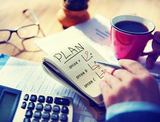 Man Writing Plan in Note Pad