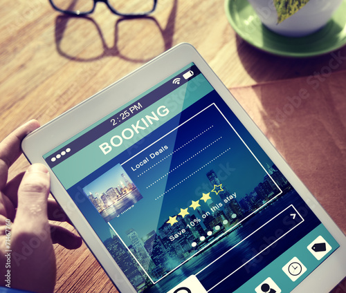 canvas print picture Man Booking Hotel Reservation on Digital Tablet