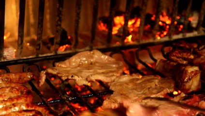 fireplace with grilled meat during cooking on the grill