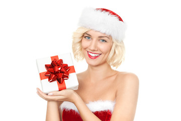 Beautiful young blond woman as santa girl with gift
