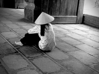 Traditional Vietnamese woman sitting on the floor