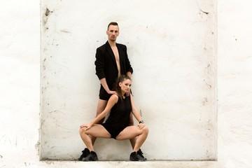 Beautiful couple of professional artists dancing