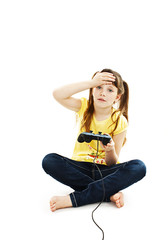 Girl using video game controller on white background