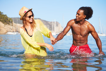 Romantic Young Couple Having Fun In Sea Together