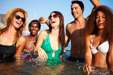 Group Of Young Friends Having Fun In Sea Together