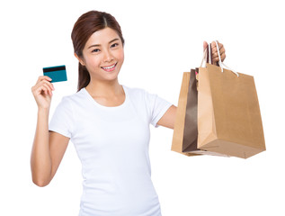 Woman hold credit card and shopping bag