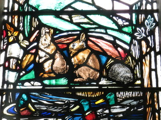 Rabbits and ducks in stained glass