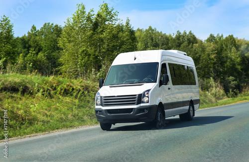 Leinwanddruck Bild minibus goes on the country highway